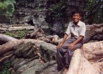 Mea sitting atop temple ruin, Ta'Prom, Angkor Wat, Cambodia, 1995.
