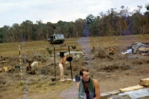 Arty crew member taking shower as chopper lands. There is no berm. The base is still being built. LZ Ranch, Snoul, Cambodia 1970 Photo: Mike Paestrella
