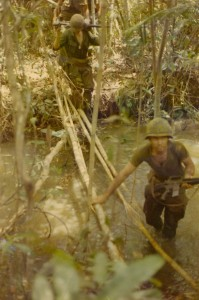 Stream crossing: Squad Leader Lloyd 'Butch' Edge followed by machine gunner Steve York. Song Be, Vietnam 1970