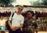 Carl with anxious Cambodian soldier. Angkor Wat, Cambodia, 1995