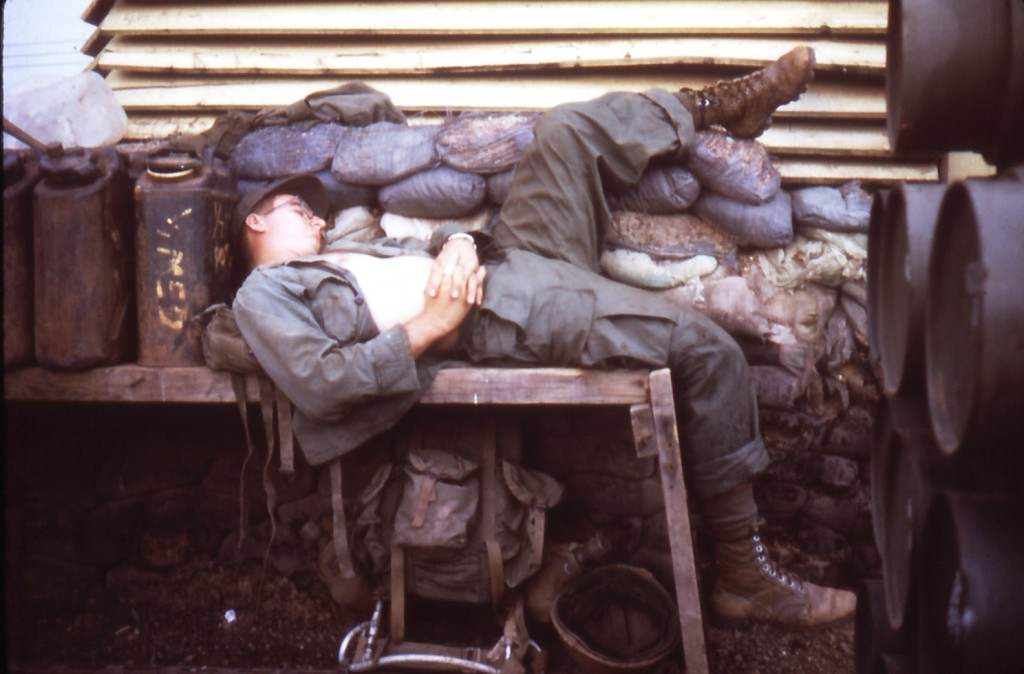 Medic at rest, 1/7 aid station, Phuc Vinh, Vietnam, 1970.