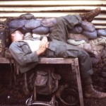 Medic at rest, 1/7 aid station, Phuc Vinh, Vietnam, 1970.
