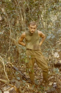 Jim Lamb in the bush getting ready for patrol. Song Be, 1969