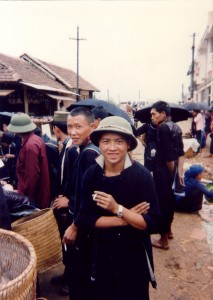 H'mong man with NVA helmet, arms crossed, central market, Sapa, 1995.