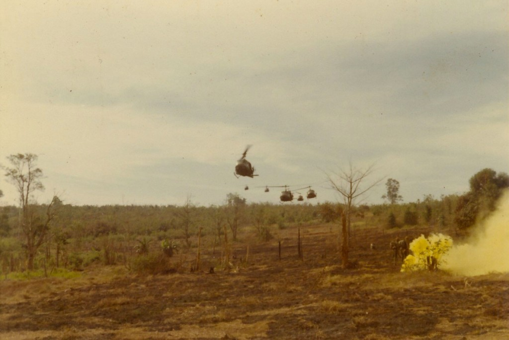 Choppers arrive to pick up grunts. Tay Ninh, Vietnam 1970.
