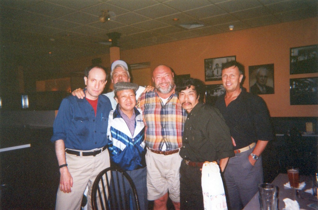 Left to right: Medic, Mr. Mau, Andy (Marines), Bao Ninh, Allen Farrell (5th Special Forces '70). Rear: Larry Heinemann. Boston, 1998