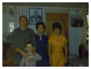 Gary Johnston, his younger brother, sister and mother. Texas, 1969