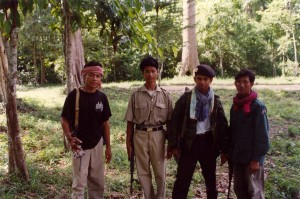 Three irregular Cambodian troops with Cambodian army soldier.  Angkor Wat, Cambodia, 1995.