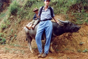 Medic with child and water buffalo. Angkor Wat, Cambodia, 1995