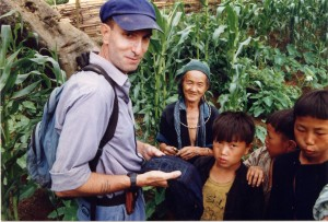 Medic in cornfield with woman and children, Sapa, 1995