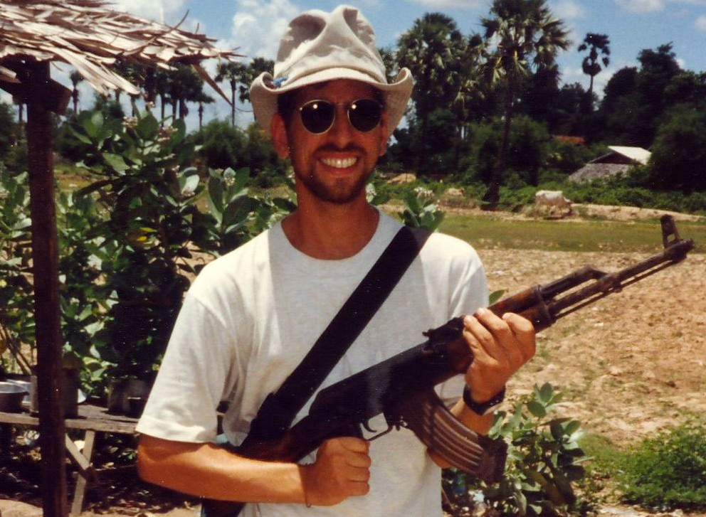 Seth with AK47 in Cambodia