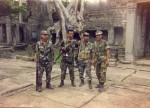 Tourist troops with B 40s and AK47s. Ta'Prom, Angkor Wat, Cambodia, 1995