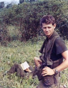 After a patrol Jeff Motyka waits in a field for inbound choppers. Tay Ninh,Vietnam 1970