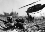 Combat operations at Ia Drang Valley,Vietnam,November 1965. Bruce P. Crandall's UH-1 Huey dispatches infantry while under fire. Photo US Army