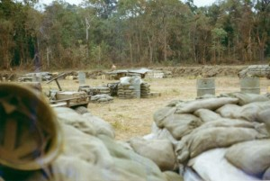 With mule and generator in foreground, view of east perimeter where sappers hit fourth platoon, then over ran the base. LZ Ranch, Snoul, Cambodia 1970 Photo: Mike Paestella