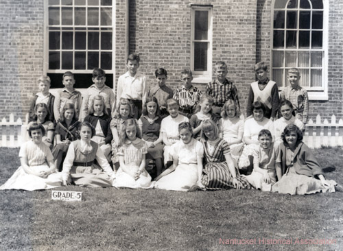Grade 5 Class Portrait:Class picture of the Academy Hill School fifth grade, 1957. Back row, left to right: Peter Metters, Frank Powers, Barry Zlotin, Dick Larrabee, Nick Ferrantella, Dennis Brown, Leonard Ringler, David Hardy, Dan Connell. Middle row: Donna Glidden, Pam Lawrence, Sandy Pope, Melodie Watts, Karen Lamb, Haydi Craig, Cynthia Perkins, Susan Lusk, Joanna Simms, Susan Michetti. Front row: Mary Jean Nelson, Sheila Fulton, Louisa Dennis, Susan Chase, Susan Tucker, Jackie Mainhart, Marie Stackpole. Academy Hill School. Nantucket 1957
