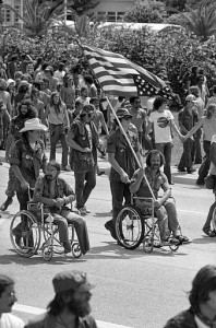 Vietnam veterans against the war and other anti-war activists march in protest near Convention Hall in Miami, Fla., Aug. 22, 1972, as the Republican National Convention opened. Disabled Vietnam vet Ron Kovic, holding an upside down American flag as a symbol of distress, is seen in the march. (AP Photo)