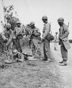 Army Engineers sweeping for mines with SCR-625 Mine Detector, France, 13 July 1944.
