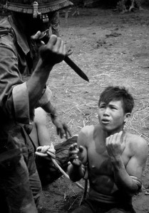 South Vietnamese soldier interogating Viet Cong prisoner. 1967
