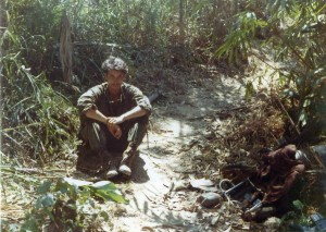 Doc Levy sitting on a well used trail